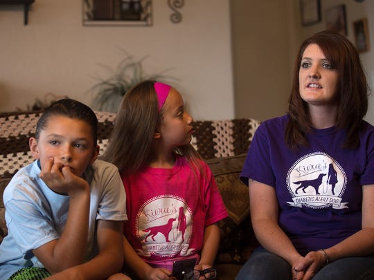 JJ Oliver,  left, Kiera Schrock and their mother Keri Schrock talk about Kiera's service dog Sugar on Wednesday at their home north of Farmington.