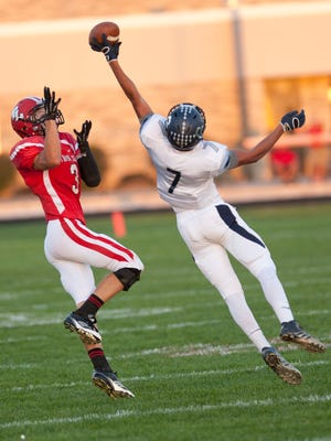 Football; Central Catholic at Twin Lakes.  CC #7 Anthony Berumen gets just enough of this pass to keep Bryce Bennington from catching it.  By Jerry Schultheiss for Journal & Courier