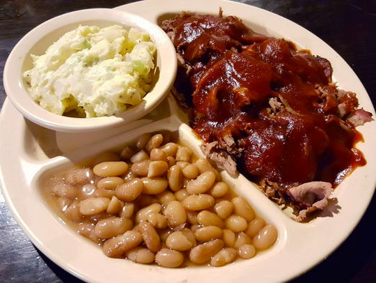 The barbecue brisket plate  ($9.75) topped with barbecue