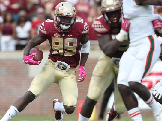 FSU's Keith Gavin runs the ball against Miami during their game at Doak Campbell Stadium on Saturday, Oct. 7, 2017.