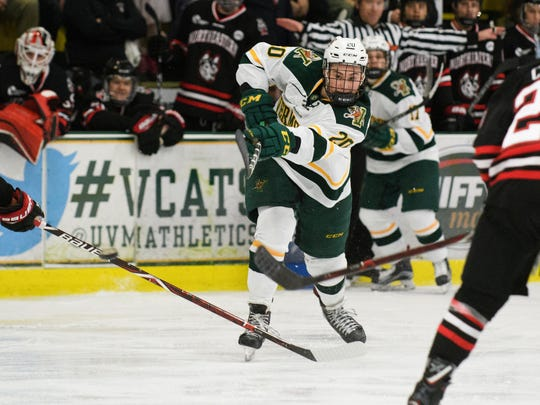 Vermont forward Ross Colton (20) shoots the puck during the men's hockey game between the Northeastern Huskies and the Vermont Catamounts at Gutterson Fieldhouse on Friday night February 16, 2018 in Burlington.