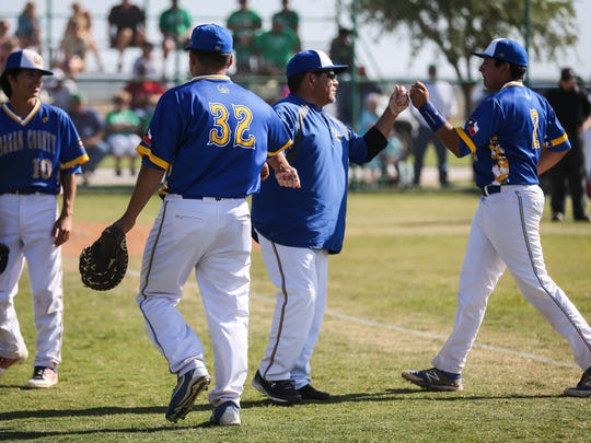 Reagan County players celebrate a good inning Monday, April 16, 2018, at Wall.