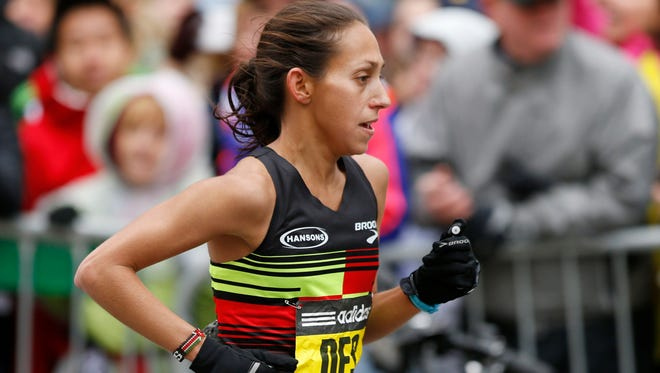 Desiree Davila Linden  (USA) near the finish line during the 2015 Boston Marathon. She would finish fourth after running with the leaders for a good portion of the race.