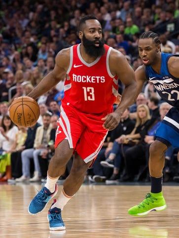 Houston Rockets guard James Harden (13) dribbles in