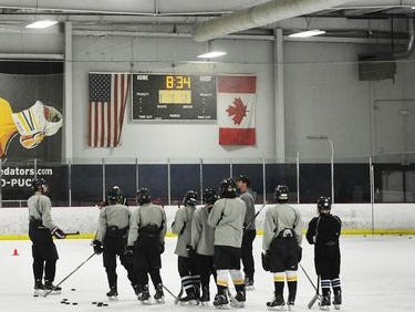 Players listen to instruction during drills at Southern Elite Sports Preparatory School, which offers students ice hockey training and education at A-Gage Sportsplex in Franklin.
