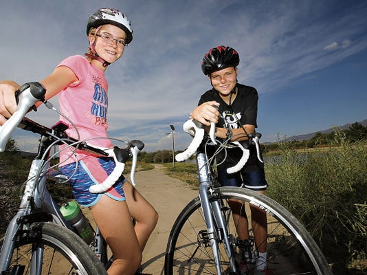 Twins Eva and Trevor Jess, 12, compete in triathlons and will take part in the Eagle in the Sun Triathlon on Labor Day weekend.