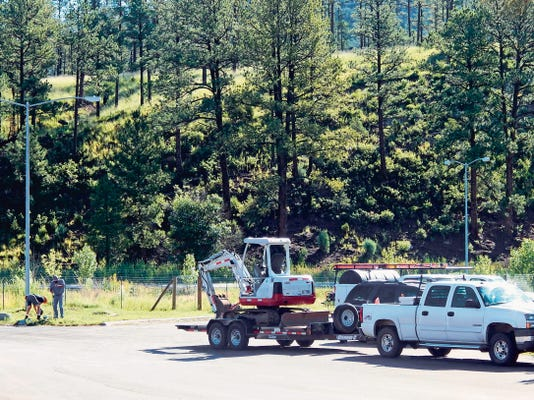 Crew assesses water leak at Ruidoso High School.
