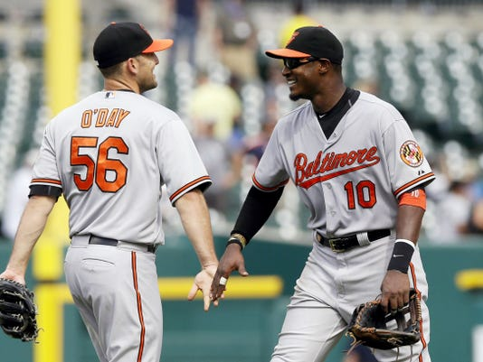 Baltimore center fielder Adam Jones congratulates relief pitcher Darren O'Day after their 9-3 victory against the Detroit Tigers during Sunday's game in Detroit.