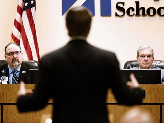 MARK LAMBIE-EL PASO TIMES  Housing Authority of El Paso CEO Gerald Cichon talks to the EPISD board as they consider taking action on school closures and consolidations Wednesday.