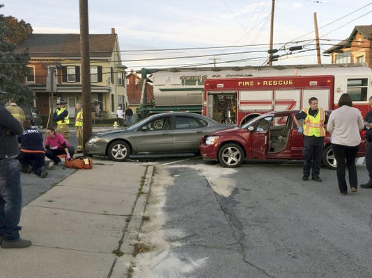 A city police officer speaks with a driver involved in a two-vehicle crash at East Lehman Street and Third Avenue at 4:35 p.m. Monday. There were no apparent injuries.  A police report was not immediately available. City fire crews and fire police assisted. John Latimer -Lebanon Daily News