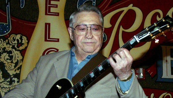 "This April 30, 2003, file photo shows Scotty Moore, a former guitarist for Elvis Presley, playing music at the 2nd annual Ponderosa Stomp in New Orleans. Moore, the pioneering rock guitarist who played on ""Hound Dog"" and other early Elvis Presley hits, has died. He was 84."