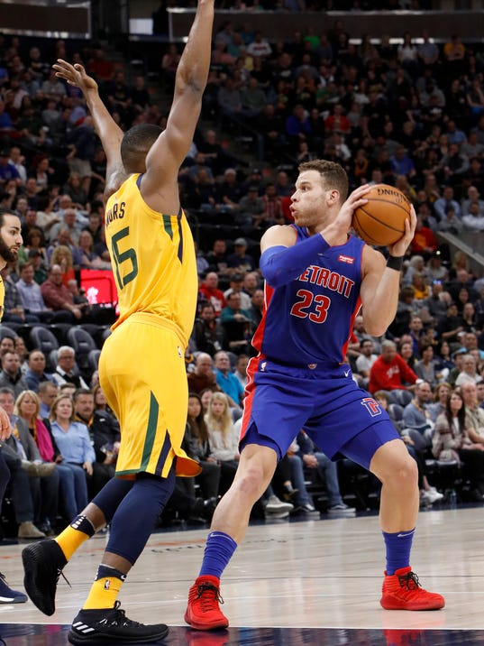 Detroit Pistons' Blake Griffin (23) looks to pass as Utah Jazz's Derrick Favors, left, defends in the first half of an NBA basketball game on Tuesday, March 13, 2018, in Salt Lake City. (AP Photo/Kim Raff)
