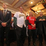 From left, Jimmy Nolan, his parents, Jimmy and Donna stand next to Yonkers Mayor Mike Spano during a fundraiser honoring Michael Nolan at Rory Dolan's in Yonkers Jan. 31, 2016. Mike Nolan, a 23-year-old baseball prospect was killed in a  shooting in Yonkers.