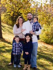 The Weakley family - Tracy and Ryan, with Ava, Kellen and Wyatt.