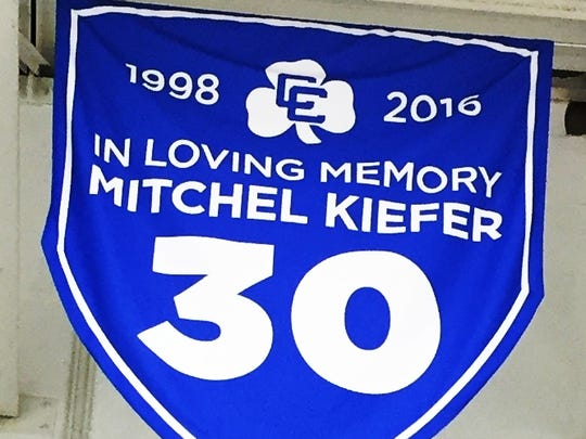 The late Mitchel Kiefer's number is hanging in the rafters at USA Hockey Arena.