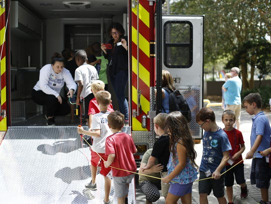 Children from Camp Challenger tour the Fire Department's