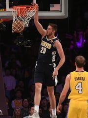 Denver Nuggets forward Tyler Lydon dunks the ball in