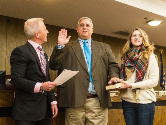 Joseph Pepitone is sworn into the Millville City Commission by New Jersey Senator Jeff Van Drew, D-1, at City Hall on Tuesday night. He stands with his daughter for the oath.