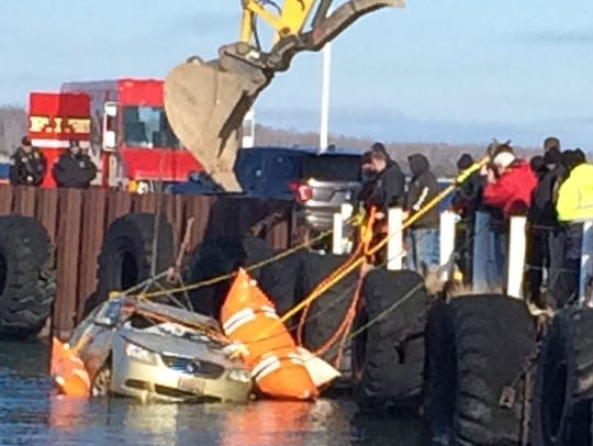 Buoyed by flotation devices, a car found submerged