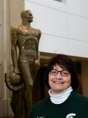 MSU Alumni Association's Sue Petrisin stands for photographs in the lobby of Spartan Stadium Dec. 18. Petrisin, the MSUAA's Associate Director for Alumni Programs, recently took office as the first woman president of Kiwanis International.