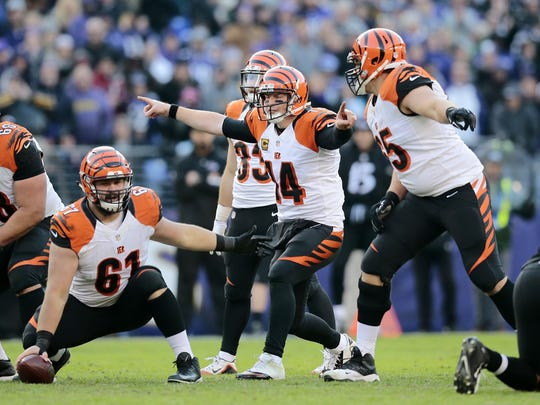 Andy Dalton (14) played through a mound of adversity this season.