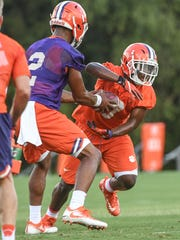 Clemson quarterback Kelly Bryant (2) hands off to running