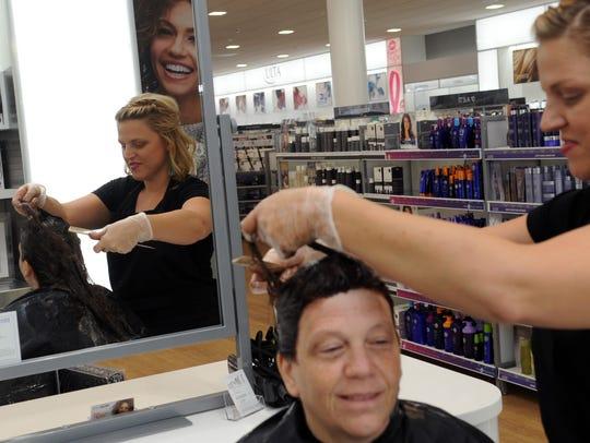 Emily Rose, designer, does Pam Butler's hair Monday