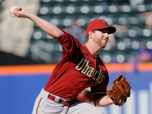 Diamondbacks pitcher Zeke Spruill  delivers the ball to the New York Mets during the first inning of the second game of a baseball double-header Sunday, May 25, 2014, at Citi Field in New York.