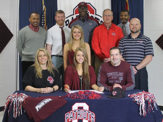 Oakland senior track athlete Morgan Wilcoxson recently signed with Cumberland University to run track and field. In the front, from left, are Julie Wilcoxson, Morgan Wilcoxson and Harlan Wilcoxson. In the back, from left, are Cumberland coach Mardy Scales, Cumberland assistant coach Stephen Register, Kayla Wilcoxson, Cumberland assistant coach Linnie Yabrough, Oakland coach Al Evans, Oakland assistant principal Sam Guydon and Oakland athletic director Brad Cowan.