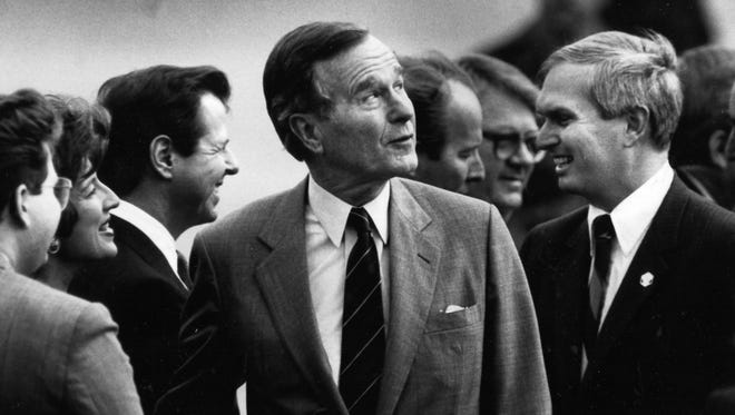 President George H.W. Bush, center, was accompanied by Rep. John J. Duncan, Jr., during a visit on Feb. 2, 1990, at McGhee Tyson Air National Guard base. Although both were Republicans, the two men weren't always in alignment.