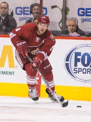 Keith Yandle skates down ice against the Blues at Gila River Arena in Glendale on Saturday, Oct. 18, 2014.