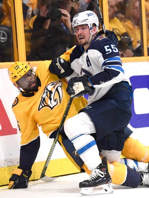 Predators defenseman P.K. Subban (76) and Jets center Mark Scheifele (55) tussle along the boards during the second period of Game 2 on Sunday.