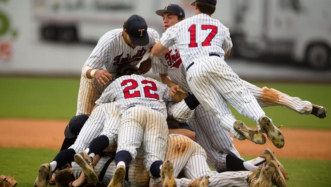 Trinity's Grant Watson (17) jumps into the dog pile after Trinity defeated Brooks 8-5 in AHSAA Class 4A State Championship Game 2 on Thursday, May 14, 2015, Riverwalk Stadium in Montgomery, Ala. Trinity won the series 2-0 winning the state title in a sweep.