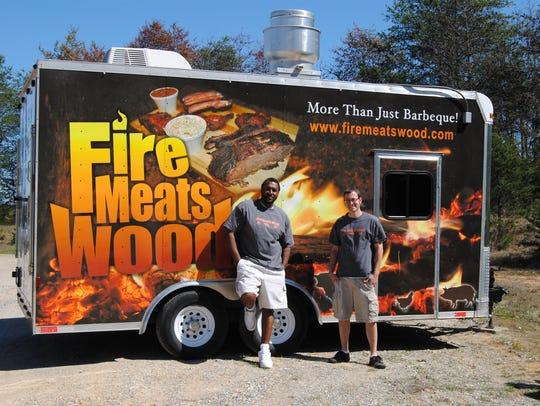 Fire Meats Wood's Lomar Benson & Josh Lord.