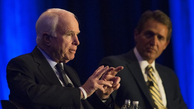 Sens. John McCain and Jeff Flake principally authored two of the 43 bills and resolutions President Trump has signed so far, according to legislation monitored by the website GovTrack.