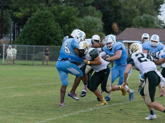 Viera High's Marco Foreman (50) tackles Rockledge's Jalen Mitchell (5).