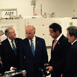 Vice President Joe Biden, right, laughs with advanced machinery student Luke Irick during a tour of the Advanced Manufacturing Center at Community College of Denver last week.