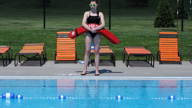 Lifeguard Brittany Elms watches over a pool during a training exercise at Drake Springs Family Aquatic Center on Thursday in Sioux Falls.