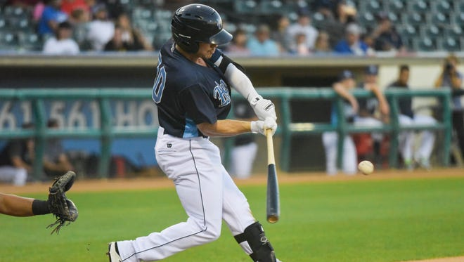 Corpus Christi Hooks outfielder Drew Ferguson hits a home run against the Frisco RoughRiders in the first inning on Monday, May 1, 2017 at Whataburger Field.