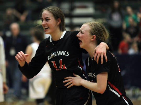 Froid-Medicine Lake's Sydney Dethman and Morgan Mason celebrate the Redhawks' third-place victory over Twin Bridges Saturday at the Butte Civic Center.