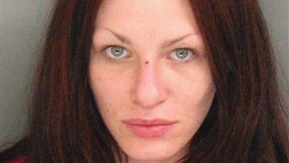 This image provided by the Santa Cruz Police Department shows Alix Catherine Tichelman after she was booked into county jail in Santa Cruz, Calif., on Friday. Tichelman was arrested on manslaughter and heroin charges after injecting heroin into a Google executive on his yacht in Santa Cruz and leaving him to die when he overdosed, according to police and a newspaper.