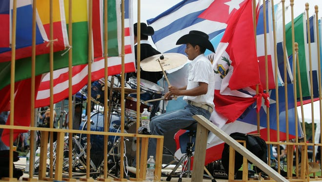 Jose Machuca, drummer for the band, La Sombra Del Golfo, performs during the annual Latino Festival for congregants of Our Lady of Guadalupe, formerly St. John the Baptist Church, at Jerry Morgan Park in Long Branch, Sunday, August 15, 2010.