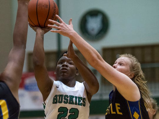 North's Fredrionna Adams (22) takes a shot as the North Huskies girls basketball team takes on the Castle Knights at North High School in Evansville, Ind., on Tuesday, Nov. 21, 2017. Castle won 60-35.