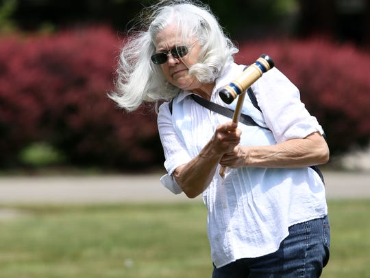 Shelley Joyce navigates her way through croquet wickets Sunday on the village green at Pringle Creek Community.
