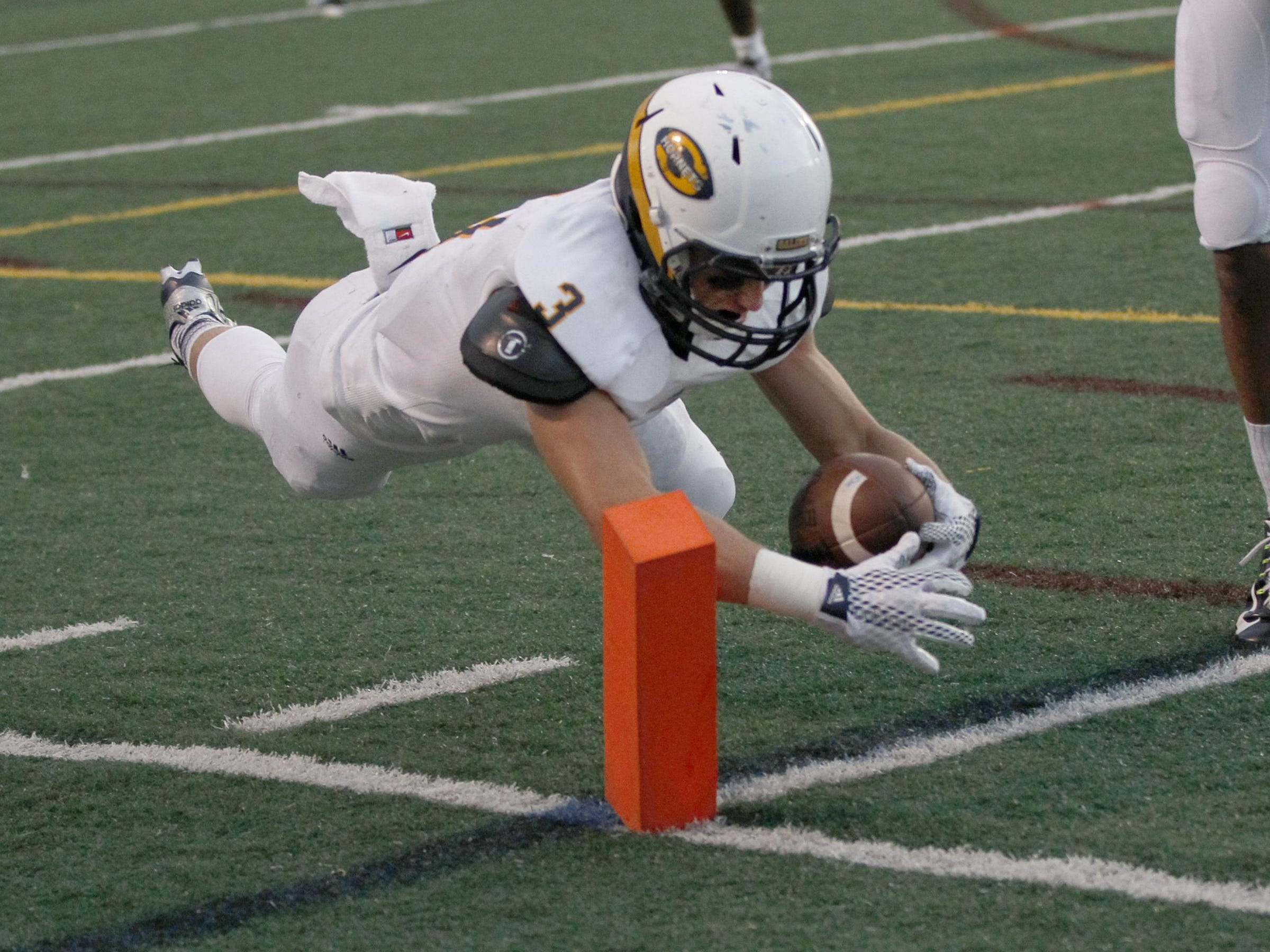 Saline Zach Schwartzenberger dives for the end zone coroner to score a touch down in the second quarter for a 10-0 lead over Ann Arbor Skyline high school on Friday, September 11, 2015, in Ann Arbor. Julian H. Gonzalez/Detroit Free Press