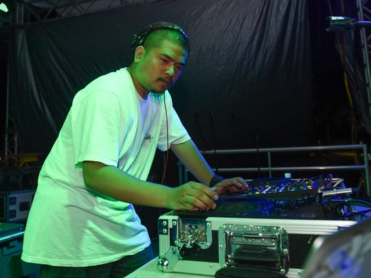 EJ Flores displays his skills on the turntables during the Guam Summer Beach Fest in Tumon on Aug. 13.
