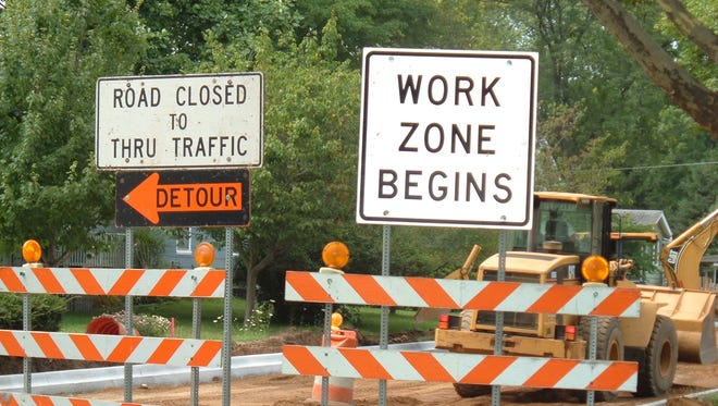 Detour and work zone signs.