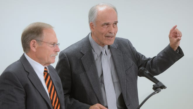 Tom Joynt, right, a UW-Milwaukee professor and former Green Bay School District superintendent, makes a final point as he turns the mic back over to moderator Dave Polashek, a district administrator in the Oconto Falls School District.