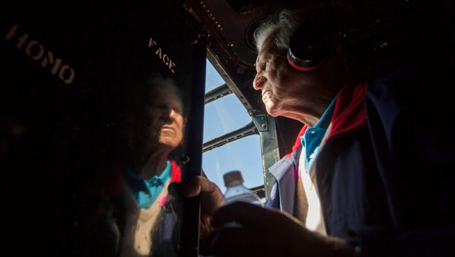 Ernie Kunz, 92, looks into the cockpit of a Consolidated B-24 Liberator during a flight from Vero Beach, Fla., to Naples Municipal Airport on Thursday, Feb. 1, 2018. The plane belongs tothe Collings Foundation, a nonprofit organization that preserveshistoric aircraft and puts them on display in the Wings of Freedom Tour.