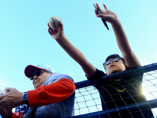 Fans wait for Hooks players to autograph their gear